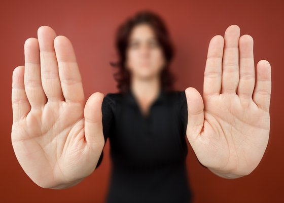Woman with her two hands extended signaling to stop